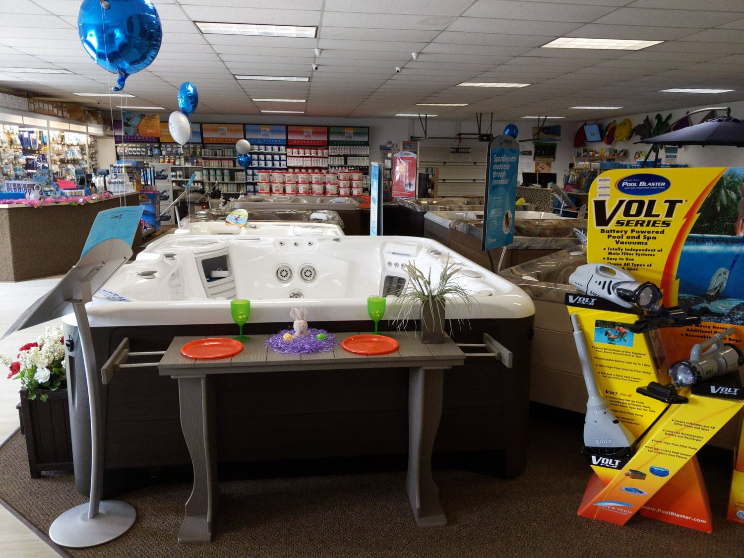Pool and spa vacuums displayed in the hot tub section of the Bloomsburg showroom