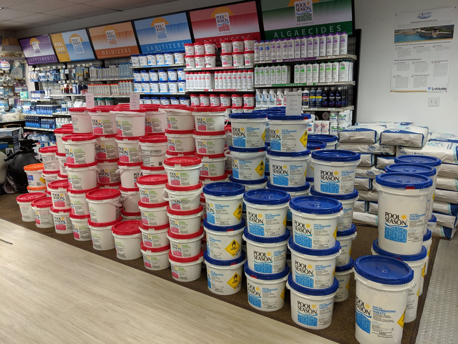 Collection of pool chemicals and balancers on display at the Bloomsburg showroom