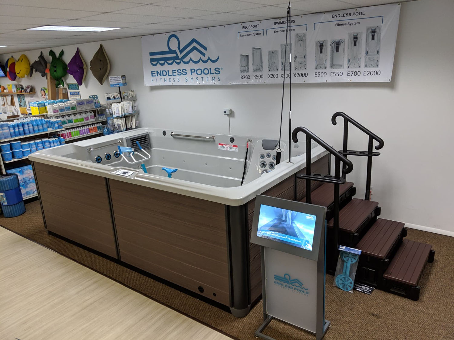 Endless Pools swim spa display model with kiosk next to the pool section in the Bloomsburg showroom
