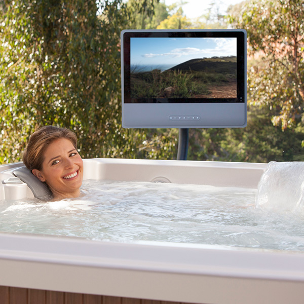 woman in the pool watching a monitor