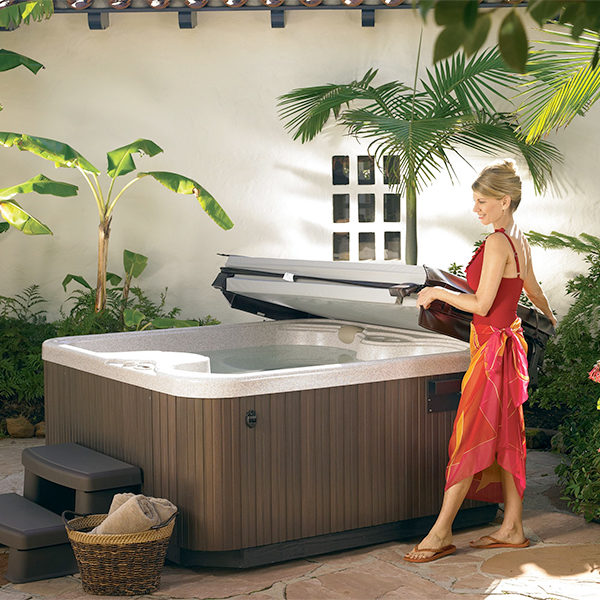 woman next to the hot tub