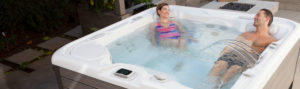 man and woman in a hot tub