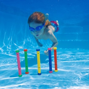 Boy underwater diving for toys