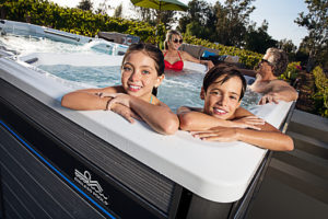 Family enjoying the hot tub end of an E2000