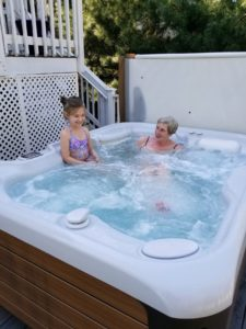 Grandmother and granddaughter in a HotSpring hot tub