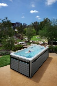 Backyard swimming in an Endless Pools Fitness System