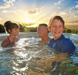 family enjoying their hot tub