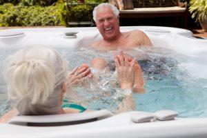 couple enjoying their hot tub