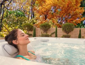 woman relaxin in hot tub in the fall